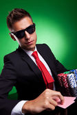 Business man playing with poker face — Stock Photo