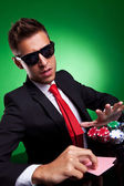 Confident young business man going all in — Stock Photo