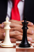 Pair of chess kings in front of businessman — Stock Photo