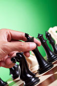 Man moving chess figure — Stock Photo