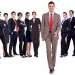 Business man walking forward leading team - Stock Photo