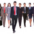 Successful happy business team walking - Stock Photo