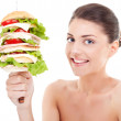 Young woman with a sandwich on a spike — Stock Photo