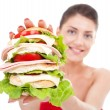 Young woman showing a sandwich - Stock Photo