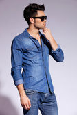 Handsome young male model wearing jeans shirt — Stock Photo