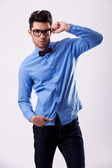Male model wearing bow tie and holding his glasses — Stock Photo