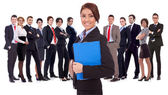 Young business woman leading a team — Stock Photo