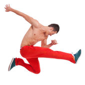 Cool looking dancer makes a difficult jump — Stock Photo