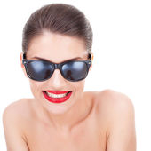 Young woman with shades is smiling to you — Stock Photo