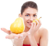 Young woman holding two pears — Stock Photo