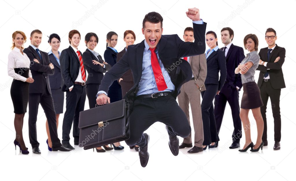 Business man holding briefcase jumping with his business team formed of young businessmen and businesswomen standing over a white background — Stock Photo #12746885