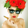 Sexy young woman with cigar — Stock Photo