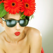 Young charming woman with flowers in her hair — Stock Photo
