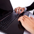 Typing male business man's hands on laptop — Stock Photo