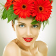 Gracefull young woman with red gerbera flowers in her hair — Foto de stock #12813046