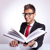 Business man offering to you his book — Stock Photo