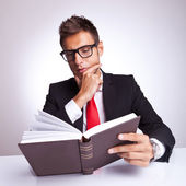 Intrigued business man reading a book — Stock Photo