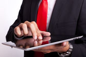 Business man tapping and browsing on pad — Stockfoto