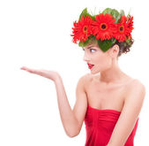Beautiful young woman with flowers on her head — Stock Photo