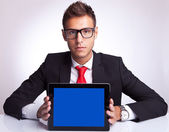 Business man showing an electronic pad — Stock Photo