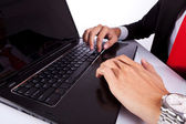 Typing male business man's hands on laptop — Stockfoto