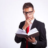 Pensive business man reading a book — Stock Photo