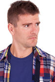 Young man looking suspiciously to a side — Stock Photo