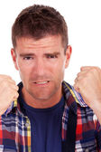 Frustrated young man shows fists — Stock Photo