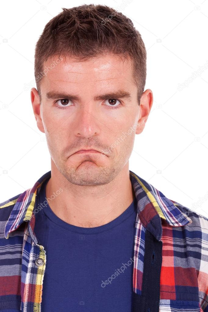 Close up portrait of an upset young man looking at camera white background   Stock Photo #13212304