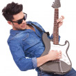 Young man plays electric guitar — Stock Photo
