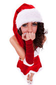 Curious woman in christmas clothes — Stock Photo