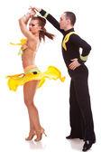 Salsa dancer spinning his female partner — Stock Photo