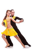 Salsa dancing couple in ballroom — Stock Photo