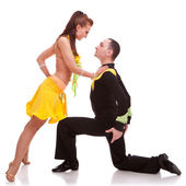Woman dancer leaning on kneeling man — Stock Photo