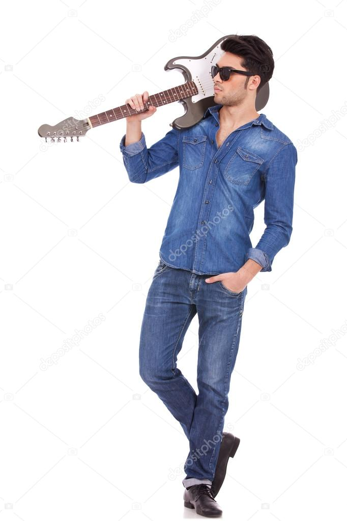 Rock you like a hurricane ! [feat Broly + libre] Depositphotos_13515806-stock-photo-young-man-with-guitar-on