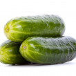 Three shiny cucumbers - Stock Photo