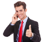 Business man talking on the smart phone and making ok — Stock Photo