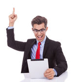 Screaming of joy while reading the good news on the tablet — Stock Photo