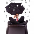 Man sitting in comfortable armchair with umbrella — Stock Photo