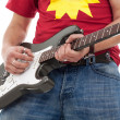 Close up of electric guitarist - Stock Photo