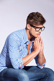 Pensive young fashion model praying — Stock Photo