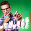 Casual man with glasses drawing a rising arrow - Foto Stock