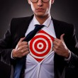 Business man showing a target under his shirt — Stock Photo