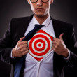 Business man showing a target under his shirt - Stock Photo