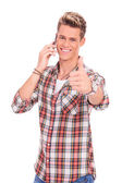 Man with thumbs up while on the phone — Stock Photo