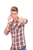 Man on the phone thumbs down — Stock Photo