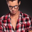 Man wearing glasses looking down — Stock Photo #15362725