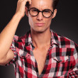 Confused casual man with glasses - Stock Photo