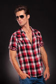 Handsome young male model with sunglasses — Stock Photo