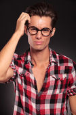 Confused casual man with glasses — Stock Photo